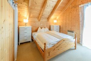 Ein Bett oder Betten in einem Zimmer der Unterkunft Ferienhaus Kreischberg