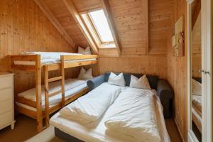 Ein Etagenbett oder Etagenbetten in einem Zimmer der Unterkunft Ferienhaus Kreischberg