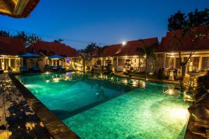 The swimming pool at or near The Palm Grove Villas
