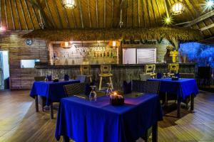 A restaurant or other place to eat at The Palm Grove Villas