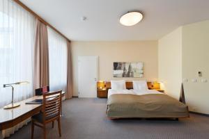 Ein Bett oder Betten in einem Zimmer der Unterkunft Hotel Glärnischhof