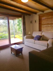 A seating area at Grand View Holiday Home