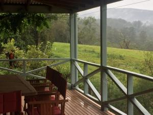 A balcony or terrace at Grand View Holiday Home