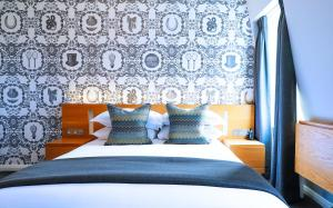 A bed or beds in a room at Malmaison Cheltenham