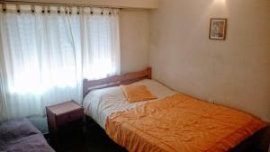 A bed or beds in a room at Departamento en Buenos Aires y PLaya