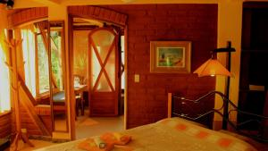 A bed or beds in a room at Finca Chamanapamba Guest House