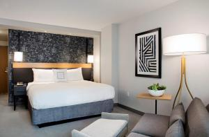 A bed or beds in a room at Courtyard Boston Downtown/North Station