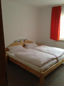 A bed or beds in a room at Pension Freund