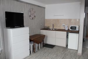 A kitchen or kitchenette at Chez Nadine
