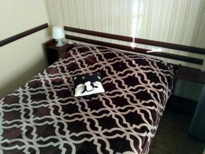 Кровать или кровати в номере Bungalow on Bannoye Lake
