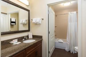 A bathroom at Staybridge Suites Sacramento-Folsom, an IHG hotel