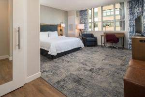 A bed or beds in a room at Hampton Inn And Suites By Hilton Portland-Pearl District