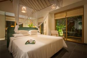 A bed or beds in a room at Alba Wellness Resort By Fusion