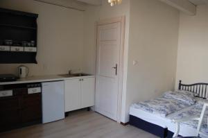 Łóżko lub łóżka w pokoju w obiekcie Lawendowy Zakątek