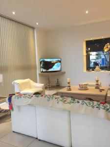 Телевизор и/или развлекательный центр в Hotel La Posta