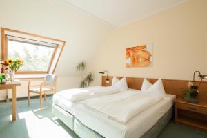 Ein Bett oder Betten in einem Zimmer der Unterkunft Apart Hotel Gera