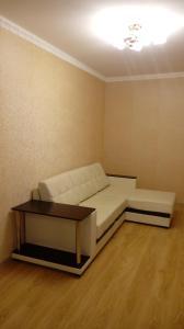A seating area at Апаптаменты на Трехсвятской