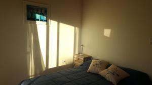 Una cama o camas en una habitación de Belgrano 238
