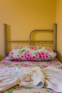 A bed or beds in a room at Cavalo Branco Hotel
