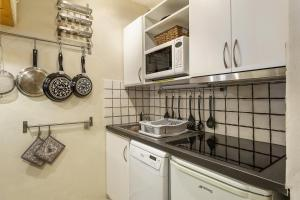 A kitchen or kitchenette at Apartment Grepon 6
