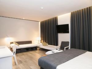 Cama o camas de una habitación en Estival Centurión Playa