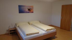 Ein Bett oder Betten in einem Zimmer der Unterkunft Apart Holidays