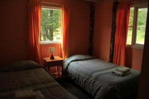 Cama o camas de una habitación en Cabañas Patagoniaventura