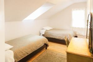 A bed or beds in a room at Orange Drive Hostel