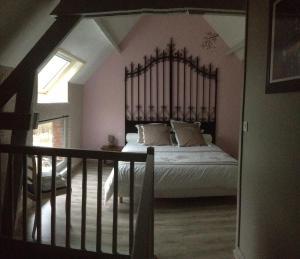 Un ou plusieurs lits dans un hébergement de l'établissement La Reine des Prés