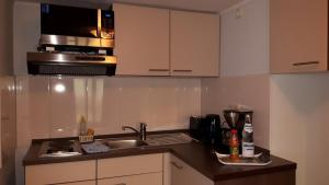 A kitchen or kitchenette at Hotel Pension Nordlicht