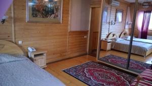 A bed or beds in a room at Hotel Gostiniy Dvor Knyaz Golitsyn