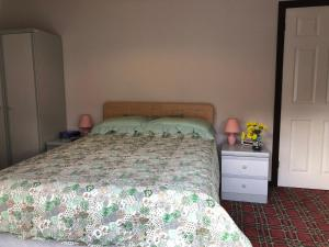 A bed or beds in a room at Fendoch Guest House