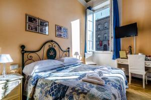 Cama ou camas em um quarto em Soggiorno Pitti