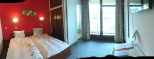 Ein Bett oder Betten in einem Zimmer der Unterkunft Hôtel de Ville