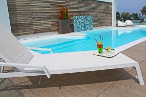 The swimming pool at or near Hotel Villa Paola