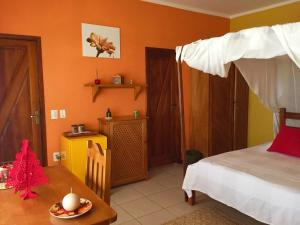 A bed or beds in a room at Sitio Sol e Mar