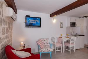 A television and/or entertainment center at Apartment Stulli 1