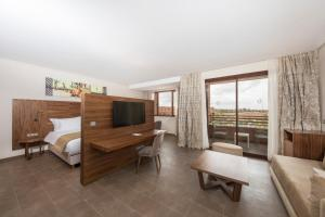 A television and/or entertainment center at Be Live Experience Marrakech Palmeraie - All Inclusive