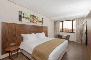 A bed or beds in a room at Be Live Experience Marrakech Palmeraie - All Inclusive