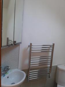 A bathroom at 2 Park Lane