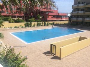 The swimming pool at or near La Perla Medano 1