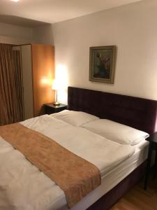 Ein Bett oder Betten in einem Zimmer der Unterkunft Hotel Villette City Center - Bellevue