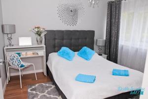 Łóżko lub łóżka w pokoju w obiekcie Apartment Double Sapphire Time