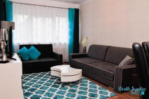 Część wypoczynkowa w obiekcie Apartment Double Sapphire Time