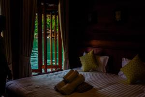 A bed or beds in a room at Panvaree The Greenery