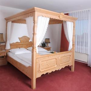 Ein Bett oder Betten in einem Zimmer der Unterkunft Hotel Blocksberg