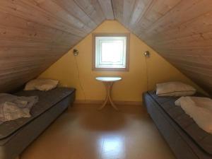 Säng eller sängar i ett rum på Vilsta Camping and Cottages