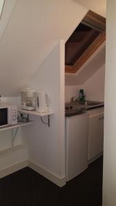 A kitchen or kitchenette at Chambres d'Hôtes La petite Salamandre