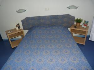 Un ou plusieurs lits dans un hébergement de l'établissement La Table Des Bons Peres