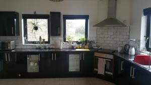 A kitchen or kitchenette at Lag Dubh Accommodation